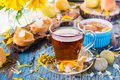A cup of black tea and jam from pears in a bowl Royalty Free Stock Photo