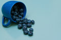 Cup of blueberries a knocked on the table Royalty Free Stock Image