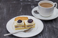 A cup of cafe latte and cake on modern table Royalty Free Stock Photos