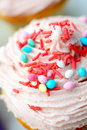 Cup cake sweet with butter cream and confetti Royalty Free Stock Images