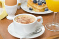 Cup of cappuccino belgian waffles with blueberries orange juic juice and egg for breakfast horizontal Stock Photography