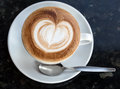 Cup of cappuccino with foam in the form heart Royalty Free Stock Photography