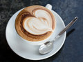 Cup of cappuccino with foam in the form heart Royalty Free Stock Images
