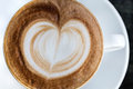 Cup of cappuccino with foam in the form heart Stock Photo