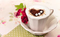 Cup of cappuccino with heart and roses Stock Photo