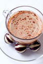 Cup of cappucino and chocolate candies Royalty Free Stock Photos
