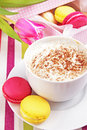 Cup of cappucino with macaroons Royalty Free Stock Images