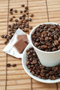 Cup with coffe beans Stock Photo