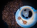 Cup and coffe grains a on background Stock Photography