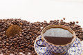 A cup of coffe  and ground coffee Royalty Free Stock Photo