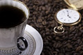 Cup of coffee against beans background closeup Royalty Free Stock Photo