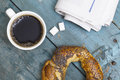 Cup of coffee with bagel and newspaper top view Royalty Free Stock Photo