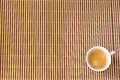 Cup of coffee on bamboo. Royalty Free Stock Photo
