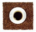 Cup of coffee on beans Royalty Free Stock Photos