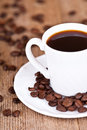 Cup of coffee and beans Royalty Free Stock Photo
