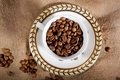 A cup with coffee beans Stock Photos