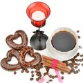 Cup with coffee, beans coffee biscuits in the form of hearts and candlestick isolated on white Royalty Free Stock Photo