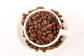 Cup of coffee beans close up white Stock Image