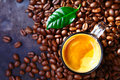 Cup of Coffee with Beans and Leaf Royalty Free Stock Photography