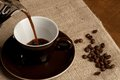 Cup of coffee and beans picture Royalty Free Stock Images