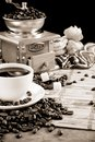 Cup of coffee, beans, pot and grinder Stock Photo