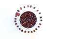 Cup of coffee beans surrounded by roasted Stock Photo