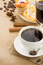 Cup of coffee with beans and sweets Royalty Free Stock Photos