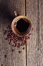 Cup of coffee and beans on vintage wooden background top view Royalty Free Stock Images