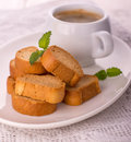 Cup of coffee biscotti some with on a white background and white tablecloth Stock Photography