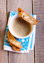 Cup of coffee and biscuits selective focus Royalty Free Stock Photo