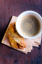 Cup of coffee and biscuits selective focus Royalty Free Stock Images