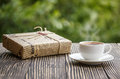 Cup of coffee  and a box   on wooden  table Royalty Free Stock Photo