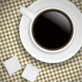 Cup of coffee on Brown tablecloth Stock Photos