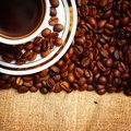 Cup coffee burlap background Royalty Free Stock Images