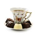 Cup coffee and candies on a white background Stock Photography