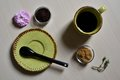 Cup of coffee with cane sugar and black spoon pink rose Royalty Free Stock Photo