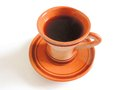 Cup of coffee ceramic brown color with black on a white background Royalty Free Stock Image