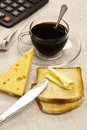 Cup of coffee, cheese and butter, newspaper Stock Image