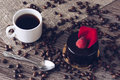 A cup of coffee with a chocolate cake with raspberries