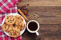 Cup of coffee and chocolate cookies top view on plate with Stock Photography