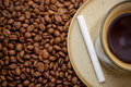 Cup of coffee and cigarette Stock Image