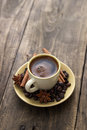 Cup of coffee with cinnamon sticks on wood rustic style Royalty Free Stock Photography