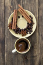 Cup of coffee with cinnamon sticks on wood rustic style Stock Photo