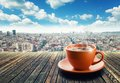 Cup of coffee on city background Royalty Free Stock Photo