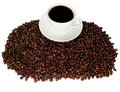 Cup of Coffee on coffee beans Royalty Free Stock Image