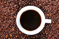Cup of coffee in coffee beans a white filled with the middle natural Stock Photo