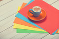 Cup of coffee and color paper Royalty Free Stock Photo