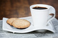Cup of coffee and a cookie. Royalty Free Stock Photo