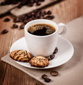Cup of coffee and cookies on the table Royalty Free Stock Photo