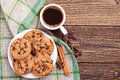 Cup of coffee and cookies top view on plate with chocolate Royalty Free Stock Photography